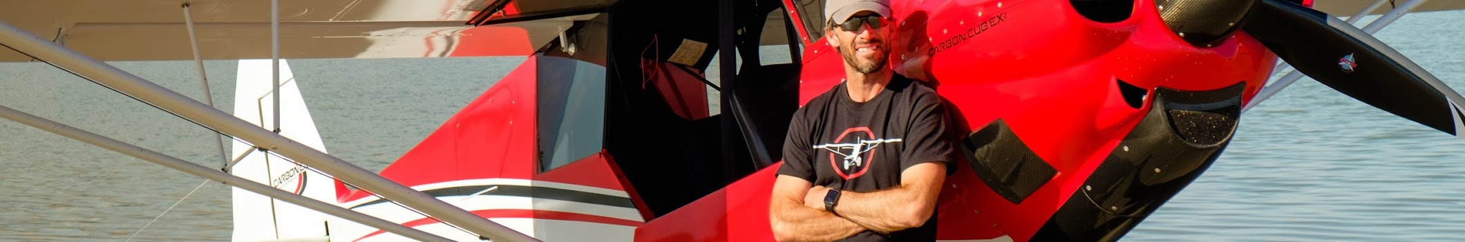 Jason Sneed leaning on his Carbon Cub EX